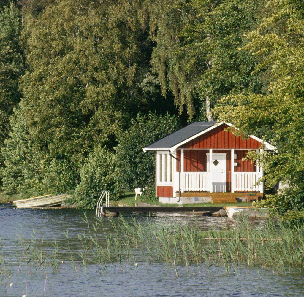View of cabin on lake
