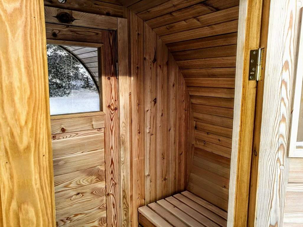 Outdoor barrel sauna with chaning room